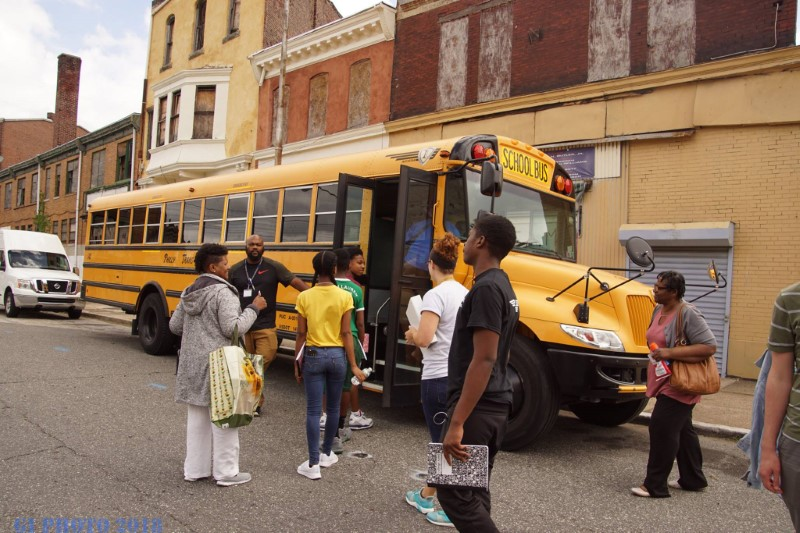 Summer Campers and Counselors get on the school bus to take a tour of historical Chester sites.