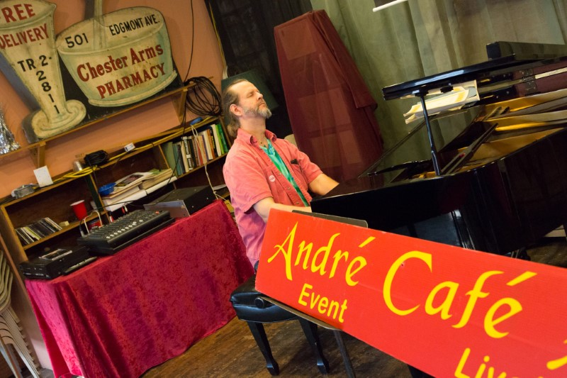 Andre plays piano in his cafe