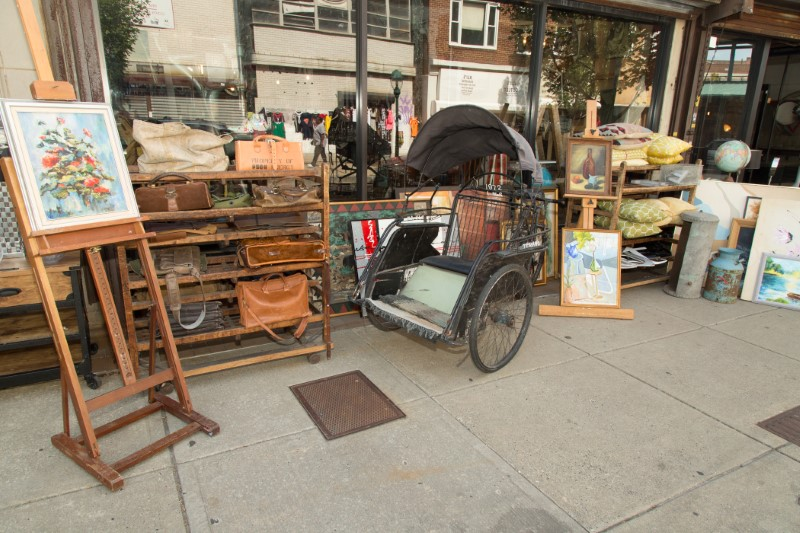 Antique items on display out front of a store front