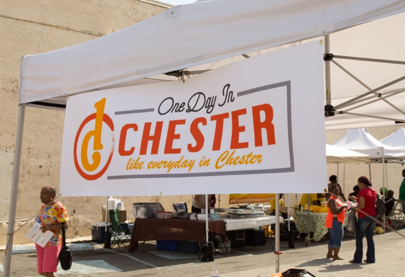 One day in Chester sign hanging in a canopy outside