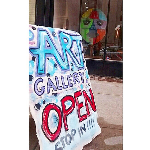 art gallery open sign outside galllery